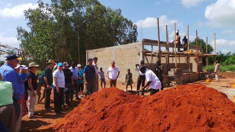 Fair attendees help build a school in Davia, Togo