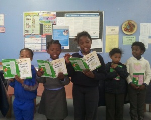 Marvin Park Primary School students reading books provided by the Rotary Club of Helderberg Sunrise.