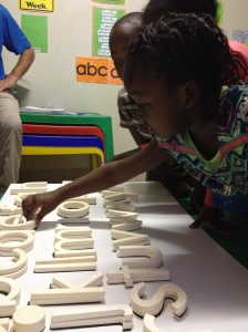 Students identify sounds to build words. Photo courtesy of Mary Jo Jean-Francois,