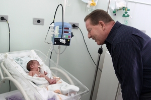 John Wahlund and a premature infant in São Francisco de Assisi Hospital ICU benefiting from Rotary supplied state of the art neonatal equipment.