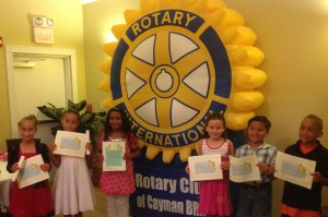 Young authors pose with their certificates of recognition for their contributions to the Butterfly Storybook