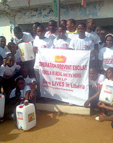 Volunteers organized by the African Dream Academy deliver containers of chlorinated water. Photo courtesy African Dream Academy