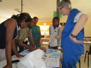 Rotarian Karin Davies administers a clinical scenario