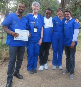 Dr. Karin Davies (second from left) and Dr. Bromberger (second from right) with training participants
