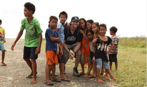 Bill Decker, a Rotary club past president and ShelterBox Response Team member, with children in the Philippines (image courtesy of Bill Decker).