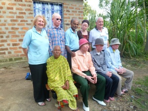 John (back row, middle) and wife Chris (back row, left) with a local family they have befriended in Ukerewe.