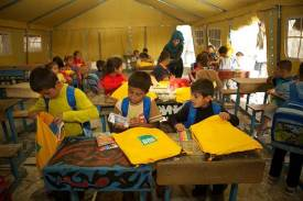 Children in Syria use ShelterBox's SchoolBoxes to continue learning during relief efforts (courtesy of ShelterBox)