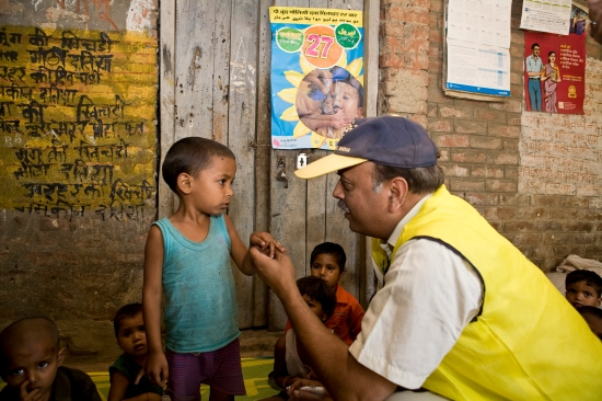 During a subnational polio immunization day, a Rotarian visits a children's center in an underdeveloped urban neighborhood outside Lucknow, India.