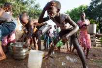 Boys cool off with water from the new well in the village of Tonosuano, Ghana.