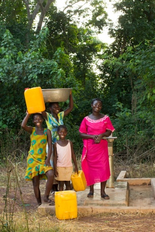 Women and girls at a repaired well in the village of Do Meabra, Ghana.