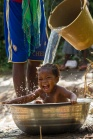 A baby is bathed with pond water near the village of Tanoano, Ghana.