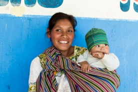 A mother and her daughter hang out outside the classrooms at Rancho Alegre schools in California, USA.