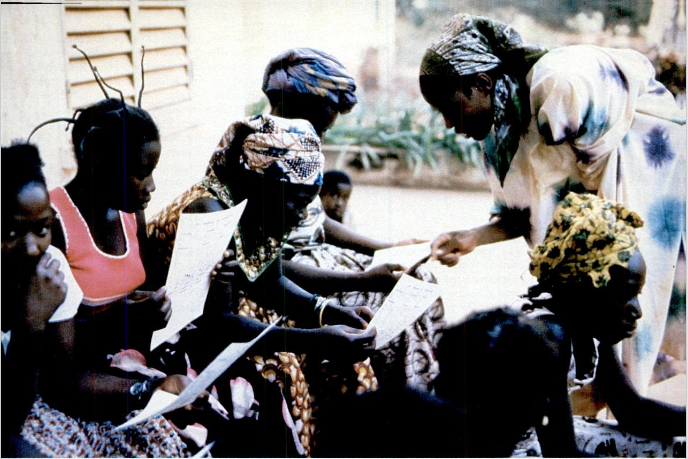 From the April 1979 Rotarian Magazine. Literacy class for girls in Africa sponsored by the World Bank.