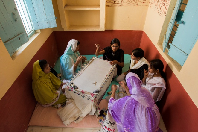 Jhoole artisans learn embroidery in Maheshwar, Madhya Pradesh, India. Jhoole, a nonprofit, fair-trade clothing company that provides its artisans with training, a living wage, health insurance, and child care.
