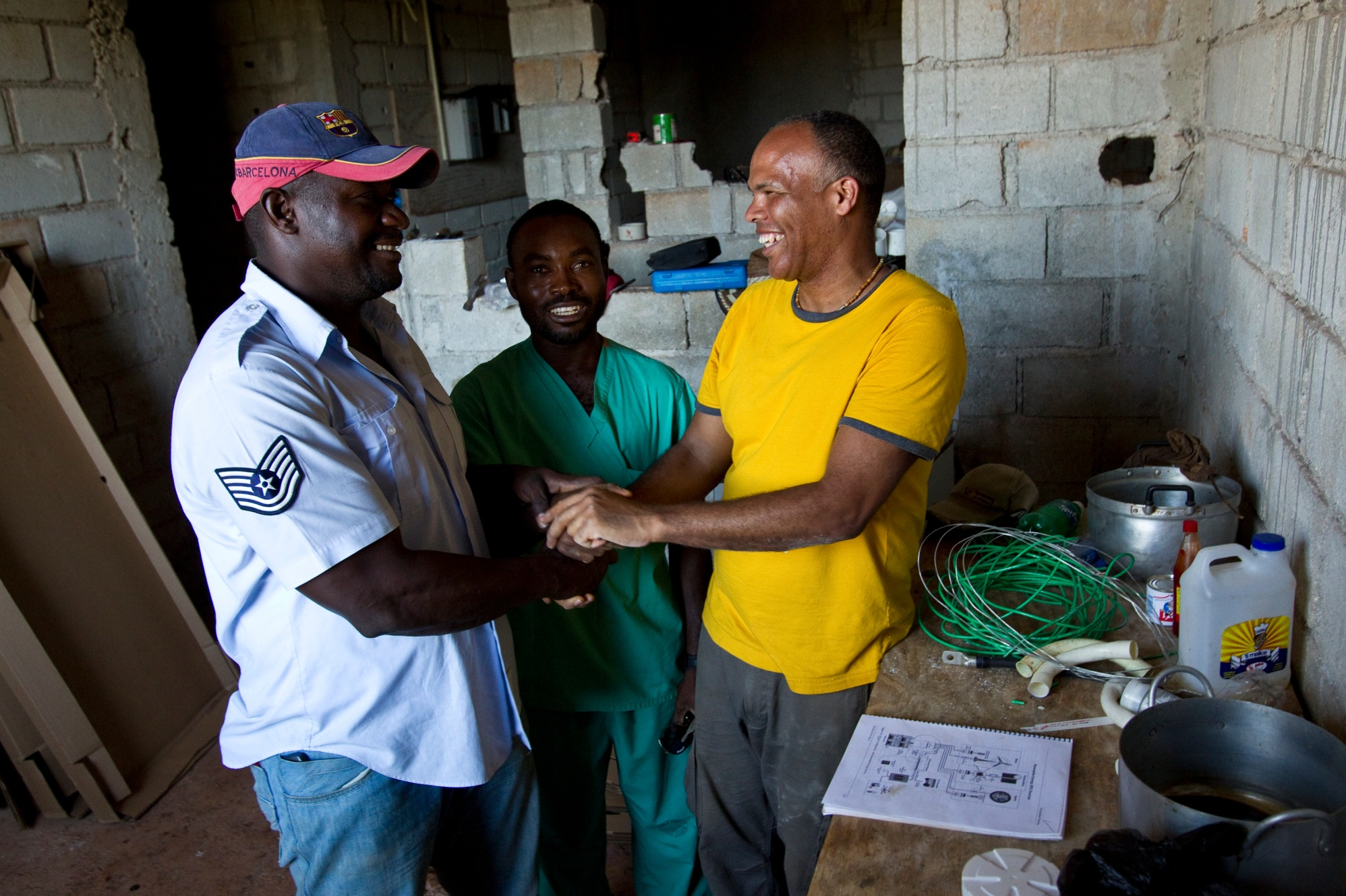 Christopher Castro (right), of the Rotary Club of Brentwood, New York, USA, trains a local technician to maintain a solar energy system in Nan Sema, on the island of La Gonave, Haiti.