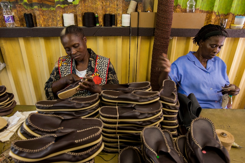 Women hand-stitch shoes at Soul of Africa's shoe factory in Durban, KwaZulu-Natal, South Africa. 3 April 2006. Soul of Africa is a nonprofit company that trains and employs women from rural KwaZulu-Natal to make shoes, and donates its profits to fund projects that help children and communities affected by AIDS.