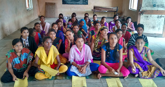 Women in a literacy program supported by the Rotary Club of Ankleshwar in India.