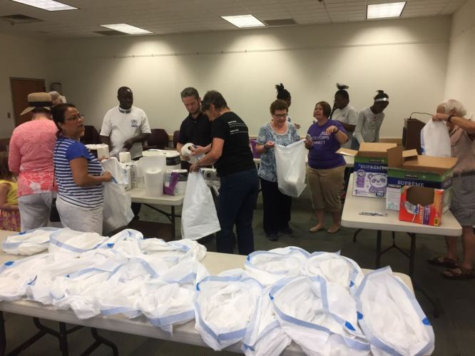 The Falls Church Rotary Club in the USA worked with a local Peace Corps chapter to pack welcome kits for refugees.