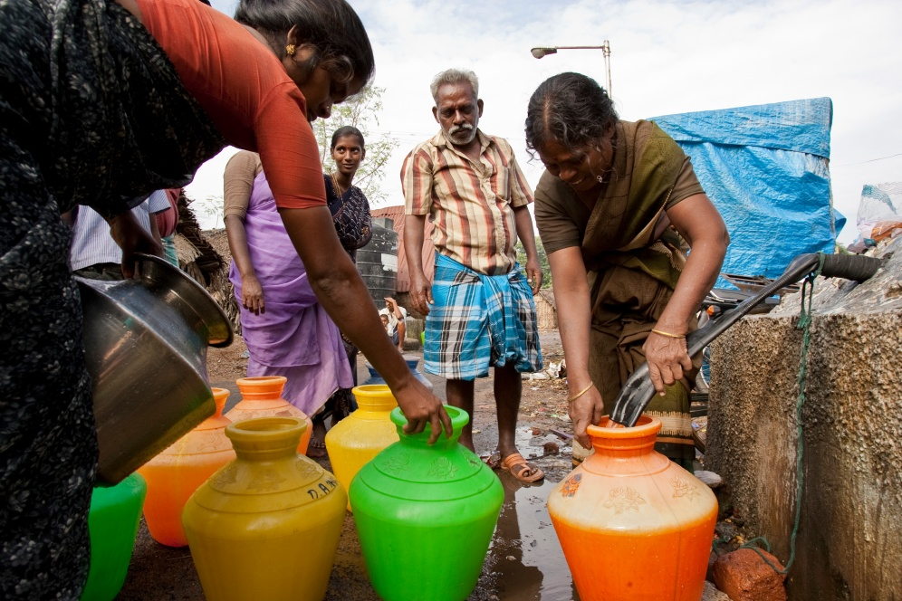 Residents draw water in one of the slums of Chennai, Tamil Nadu, India.