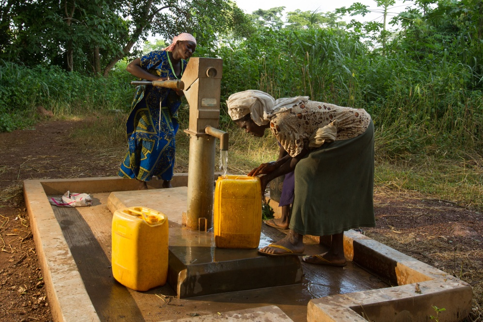 Women operate a repaired well in the village of Do Meabra, Ghana.
