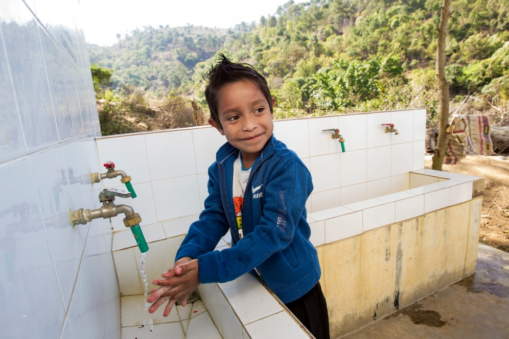A student washes his hands after using the bathroom at El Tunino school. The school is one of nine in the Sumpango area of Guatemala at which Rotary is improving water and sanitation facilities through a global grant.