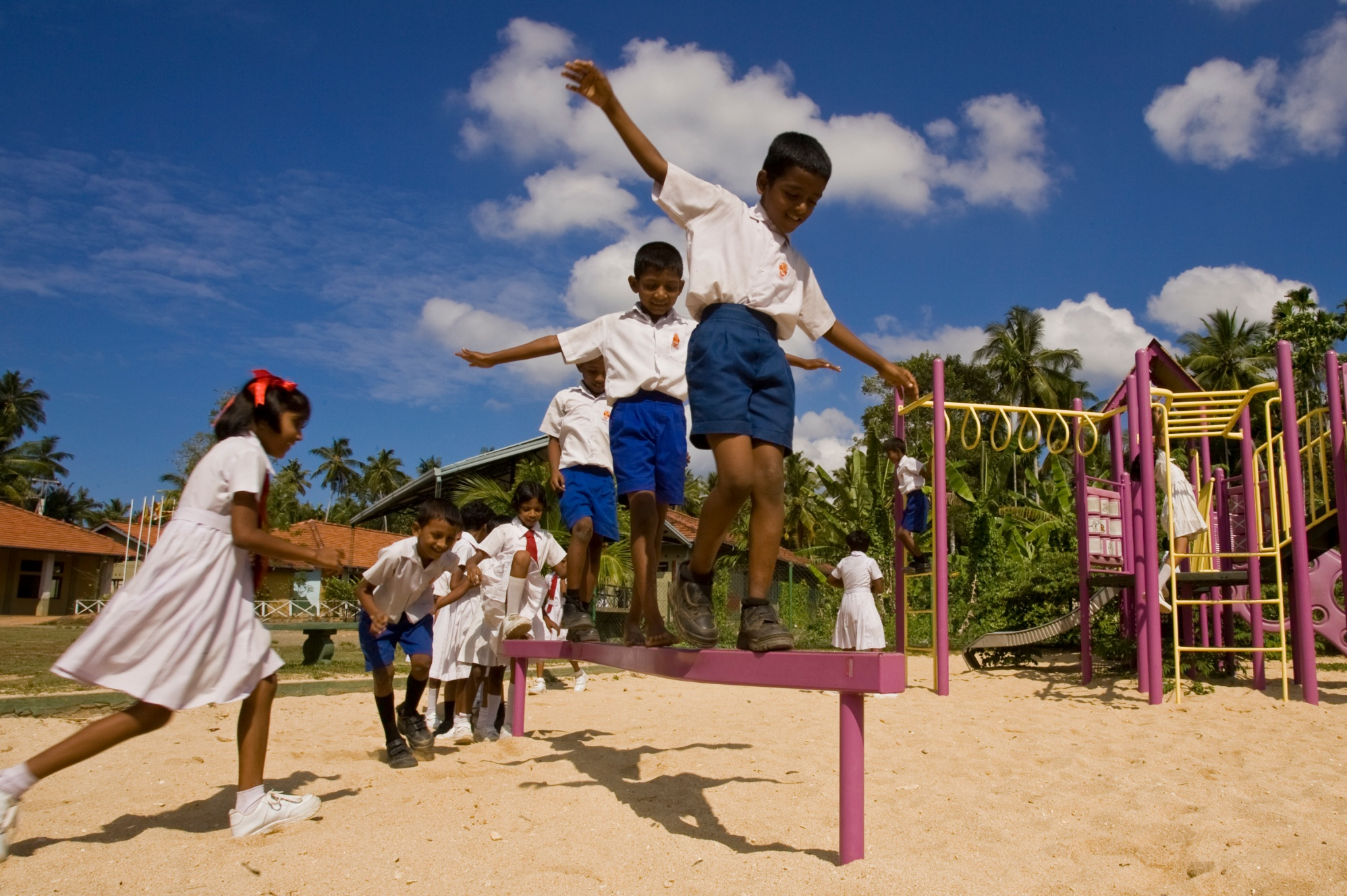 Students on the playground at Dharmarama Kanishta Vidyalaya in Ahangama, Sri Lanka. This school was rebuilt through the Schools Reawaken project after the 2004 tsunami. District 3220 (Sri Lanka) raised funds for the project and received support from The Rotary Foundation, Standard Chartered Bank, and other contributors. A local Buddhist temple donated the land.