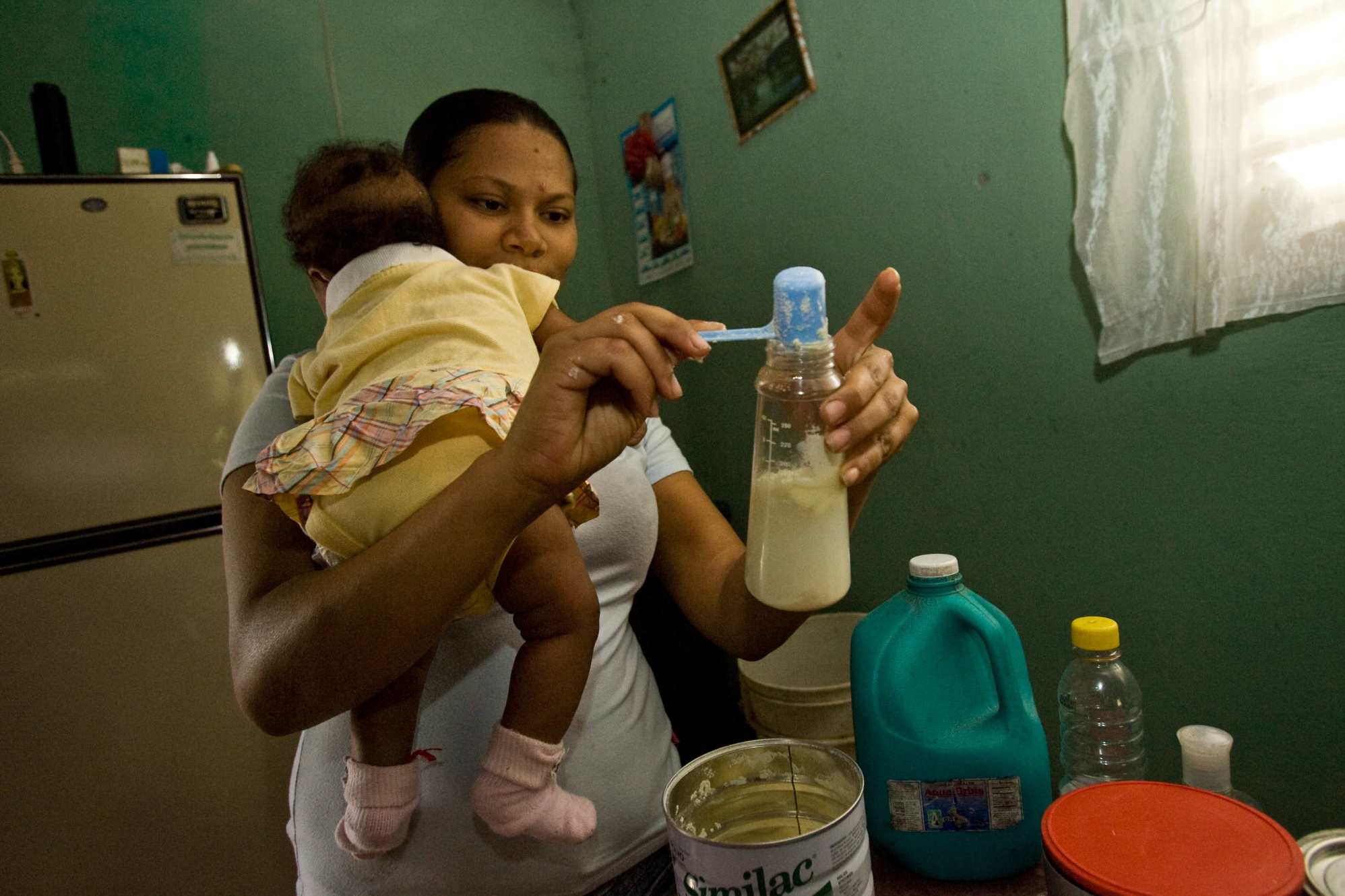 A woman in Luperon, Dominican Republic, can give her child a clean bottle because of the bio-sand water filter in her home.