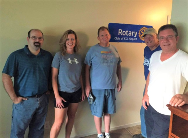 Members of the KCI Rotary Club outside the apartment they sponsor at Hillcrest Platte County